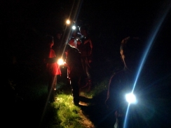 Children with torches on a bat walk in Beacon Quarry.